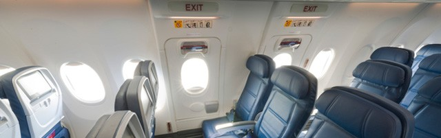 Main Cabin seats in the emergency exit rows inside a Boeing 737-900ER (739).