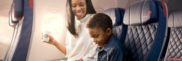 Woman and child sitting in Delta Comfort+