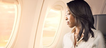 Woman looking out the window in the First Class cabin