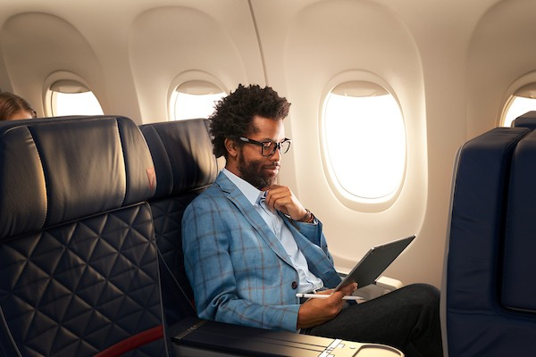 A business traveler working on his tablet